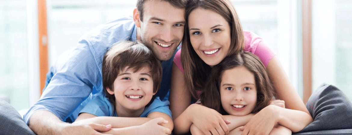 smiling family, parents and their two children