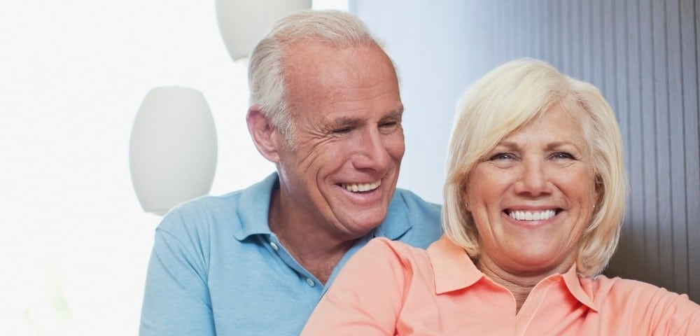 senior couple that are smiling with restored teeth